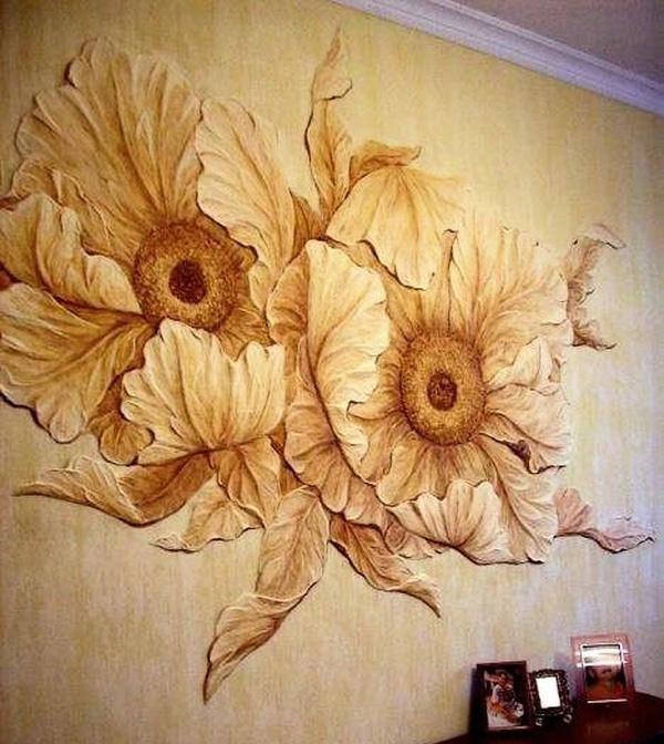 Рельефные рисунки на стене